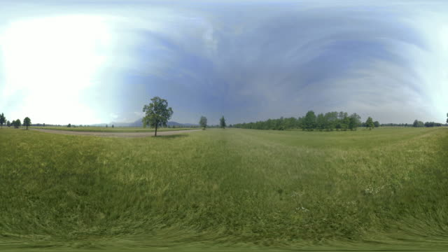 AERIAL VR 360: Rising above a field in sunshine
