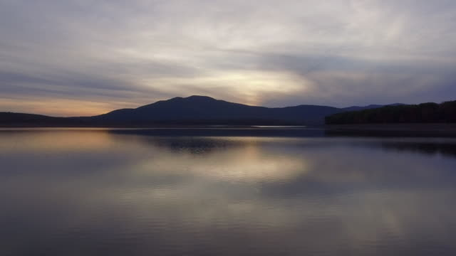 rising aerial pov of ashokan reservoir during sunset - reservoir stock videos and b-roll footage
