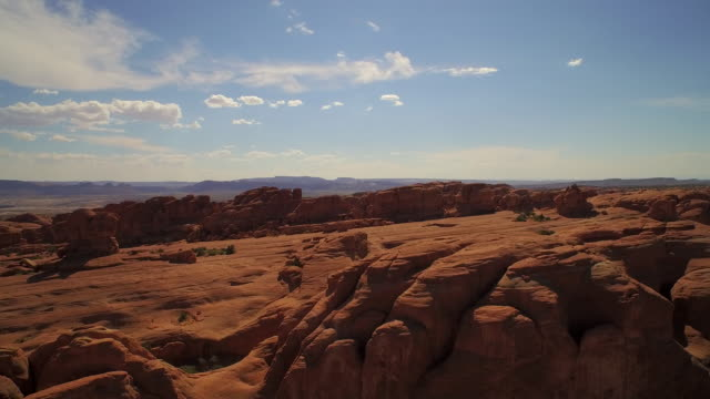 Rising aerial shot above The Elephant Arch at The Arches National Park