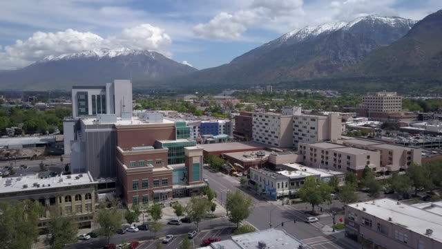 rising aerial view flying over buildings in downtown provo, utah - provo stock-videos und b-roll-filmmaterial