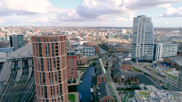 rising aerial view leeds bridgewater place and candle house apartments - barge stock videos & royalty-free footage
