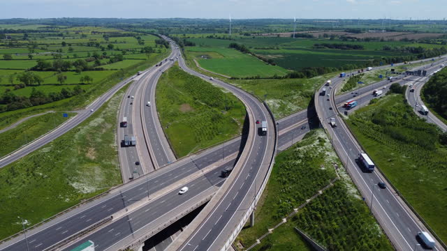 rising aerial view of catthorpe interchange. a major intersection of the m6, m1 and a14 roads. - aircraft point of view stock videos & royalty-free footage