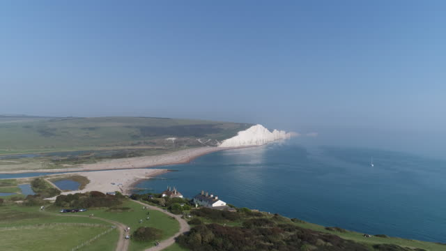 Rising aerial view of Cuckmere Haven and white cliffs of Birling Gap