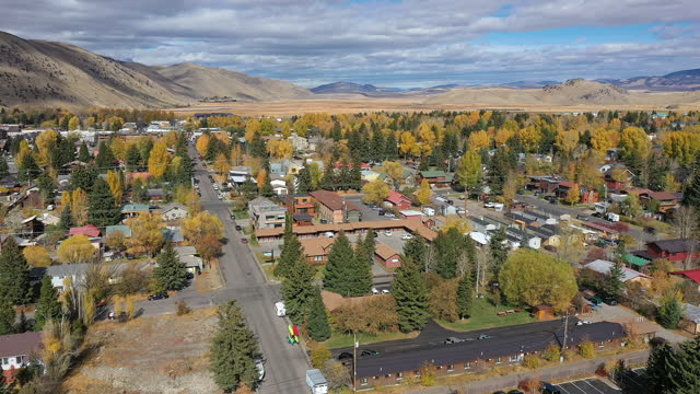 rising aerial view of jackson hole wyoming during fall - wyoming stock videos & royalty-free footage