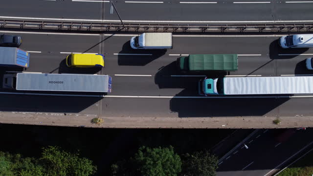 rising aerial  view of traffic queuing. - connection stock videos & royalty-free footage