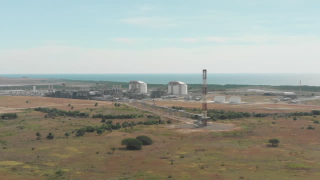 rising drone shot of oil refinery near port moresby - papua stock videos and b-roll footage