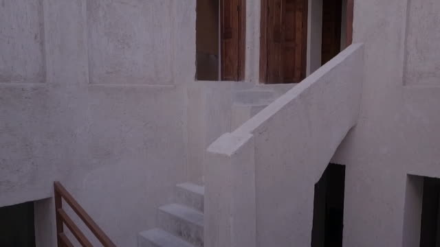 rising drone shot through the internal stairwell to the barajeel or windcatcher of a traditional house. - staircase stock videos & royalty-free footage