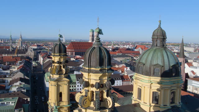 rising flight from hofgarten past theatiner church - rathaus stock videos & royalty-free footage