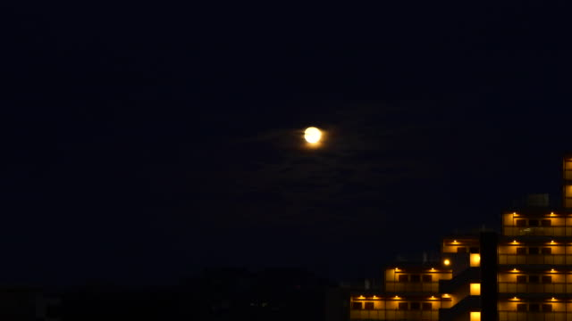 rising of moon above the residential buildings - plusphoto stock videos & royalty-free footage