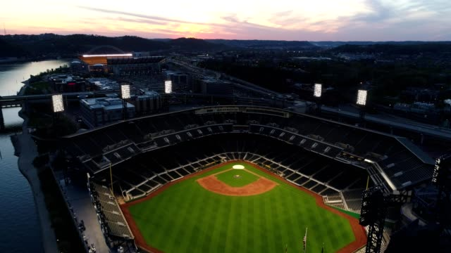 rising over pnc park at sunset - back lit stock-videos und b-roll-filmmaterial