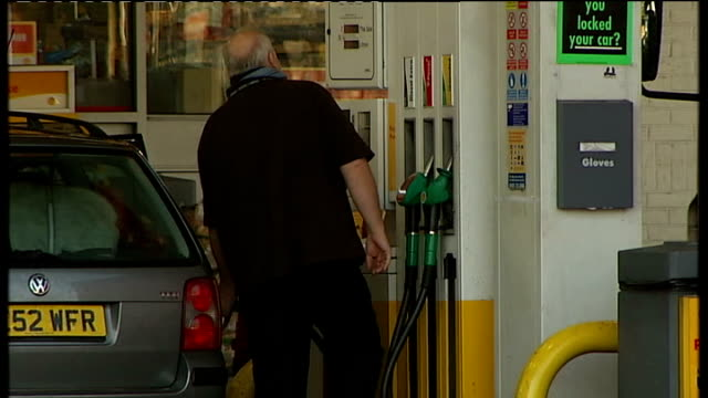 manchester ext people filling cars with petrol at shell petrol station / wide shot of shell garage forecourt / unleaded and diesel petrol prices... - unleaded stock videos and b-roll footage