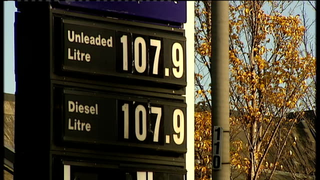 Rising petrol prices Exterior shot of Texaco petrol station forecourt / Close up of Unleaded and Diesel petrol prices displayed / Cars driving down...