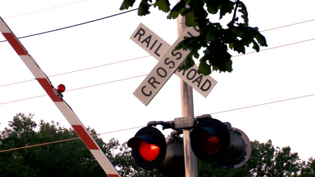 rising rail road, crossing sign - level crossing stock videos & royalty-free footage