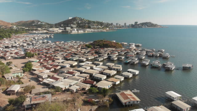 rising shot over water village in port moresby - papua new guinea stock videos & royalty-free footage