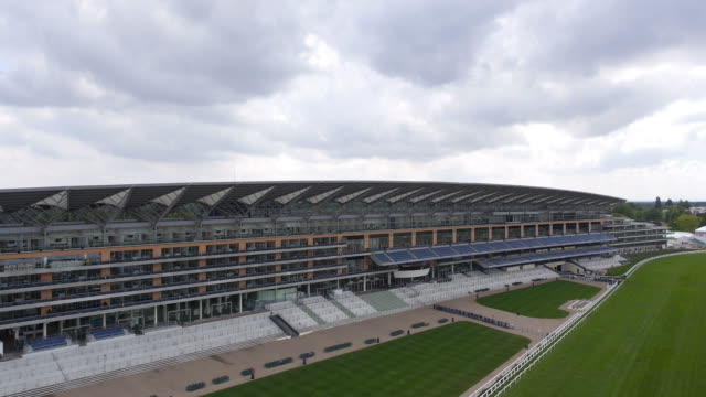 rising side aerial view of the new grandstand at ascot racecourse - captured by a licensed uav operator with pfaw - イギリス アスコット競馬場点の映像素材/bロール