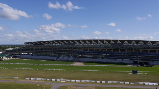 rising side aerial view of the new grandstand at ascot racecourse - captured by a licensed uav operator with pfaw - ロイヤルアスコット点の映像素材/bロール