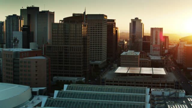 rising sun glinting on office towers in downtown phoenix - drone shot - arizona stock videos & royalty-free footage