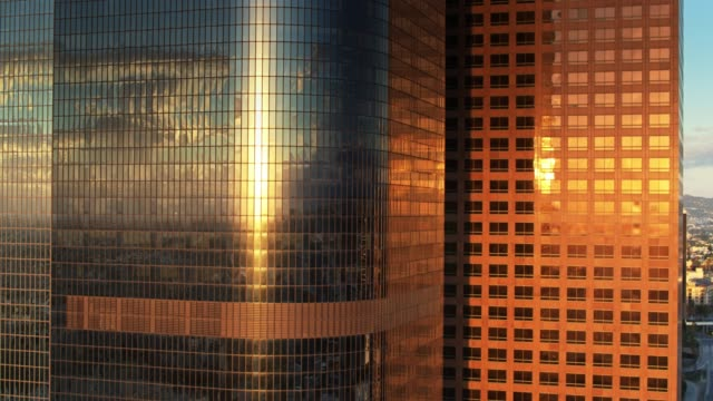 Rising Sun Reflected on DTLA Office Towers - Aerial