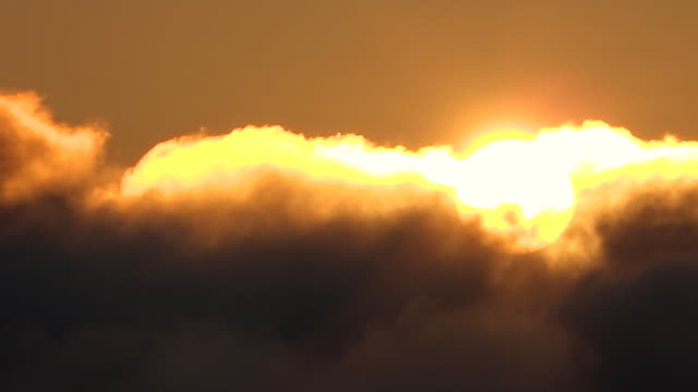 rising sun visible amid the moving clouds viewed from hakusan - ishikawa prefecture stock videos and b-roll footage