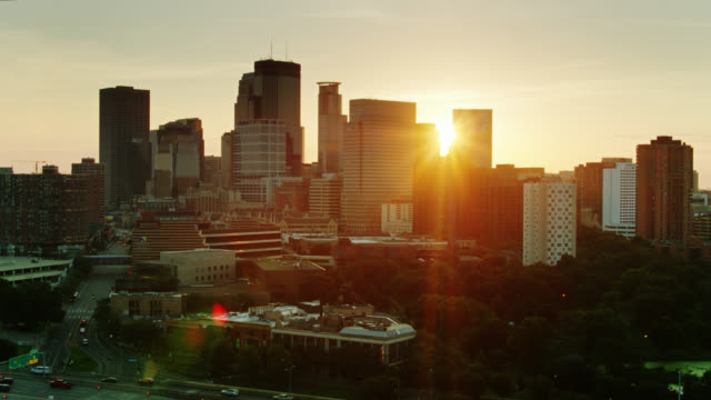 rising sunlight creating dramatic lens flare in drone shot of minneapolis - minnesota stock videos & royalty-free footage