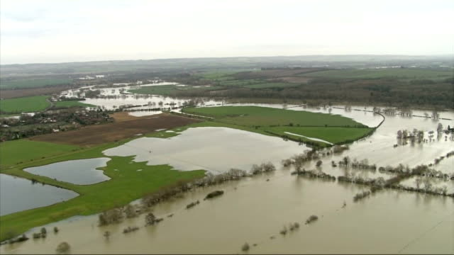 rising uk flood levels and more rain predicted flooding in oxfordshire air views flooded countryside/fields / white van submerged in flood water in... - oxfordshire stock videos & royalty-free footage