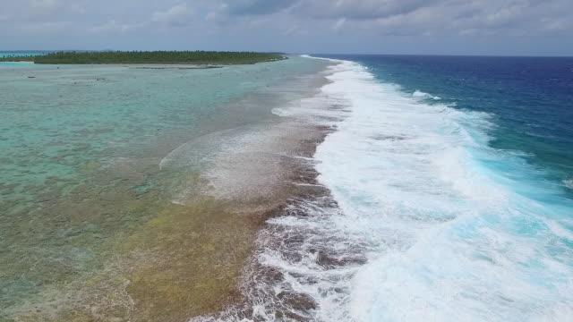 Rising view of big breaking waves on Aitutaki coral reef