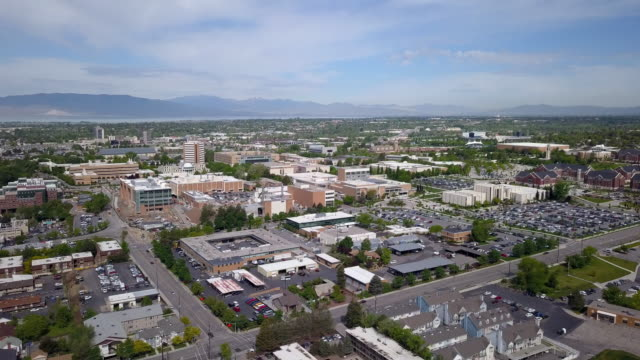 rising view tilting down near byu campus - provo stock-videos und b-roll-filmmaterial
