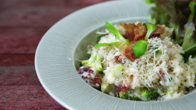 risotto rice with bacon - plate stock videos and b-roll footage