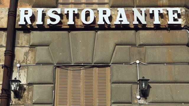 ristorante sign on an building in rome - milan stock videos & royalty-free footage