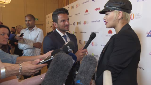 rita ora, peter andre on winning best female, the charity, 'x factor' at silver clef awards on july 03, 2015 in london, england. - リアリティー番組点の映像素材/bロール