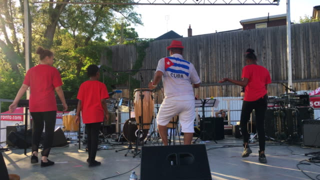 ritmo caliente dance show performing in the folklore stage in the intersection of winona drive and saint clair avenue west the leader has a cuban... - salsa stock videos & royalty-free footage