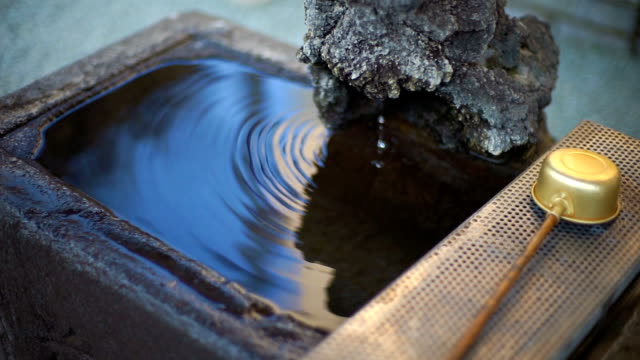 Ritual drinking water at the Japanese Temple in Japan