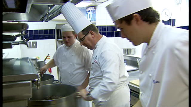 ritz chef gives christmas dinner tips england london the ritz int chefs at work in kitchens of the ritz and cooked turkey on silver platter - silver platter stock videos and b-roll footage