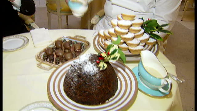 ritz chef gives christmas dinner tips; reporter to camera and sampling christmas desserts provided by chef john williams - dessert stock videos & royalty-free footage