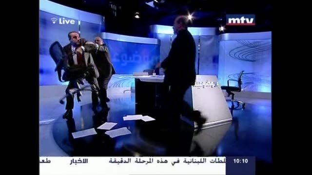 rival lebanese politicians came to blows live on national television over the crisis in neighbouring syria hurling insults and chairs at each other... - television show stock videos & royalty-free footage