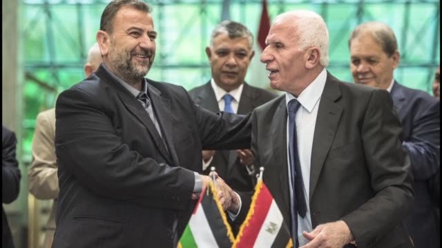 Rival Palestinian movements Fatah and Hamas signed a reconciliation deal in Cairo on Thursday aimed at ending their decade long split following...