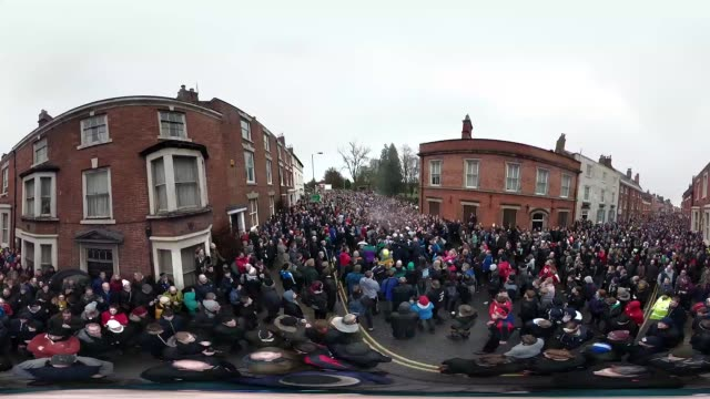 rival teams the 'up'ards and down'ards' battle for the ball during the annual ashbourne royal shrovetide 'no rules' football match on february 13,... - ダービーシャー点の映像素材/bロール