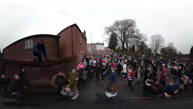 Rival teams the 'Up'ards and Down'ards' battle for the ball during the annual Ashbourne Royal Shrovetide 'no rules' football match on February 13...