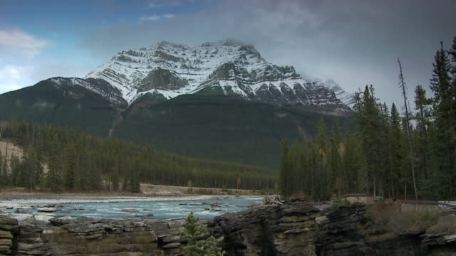 ws slo mo river above athabasca falls with rocky mountain in background / jasper national park, alberta, canada. - athabasca falls stock videos and b-roll footage