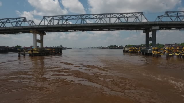 river and bridge in pontianak west kalimantan indonesia on wednesday may 2 2018 - kalimantan stock videos and b-roll footage