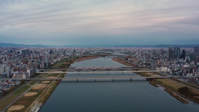 river and building in osaka city, japan. - 大阪駅点の映像素材/bロール