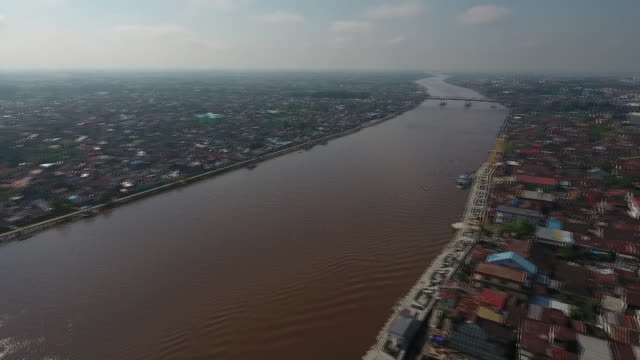 river and cityscape of pontianak west kalimantan indonesia on wednesday may 2 2018 - kalimantan stock videos and b-roll footage