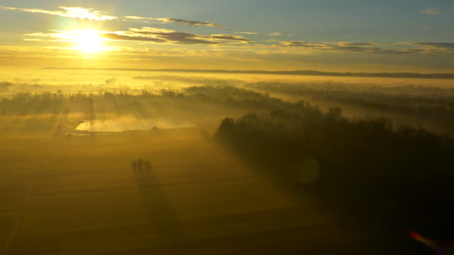 aerial river and countryside in morning mist - prekmurje stock videos & royalty-free footage