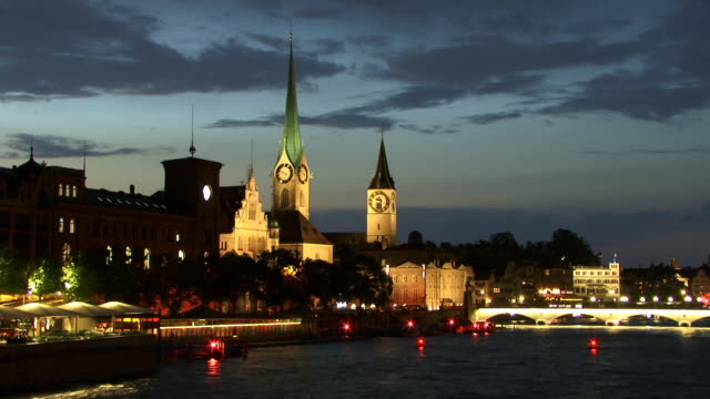 t/l, ws, river and illuminated city at dusk, zurich, switzerland - establishing shot stock videos & royalty-free footage
