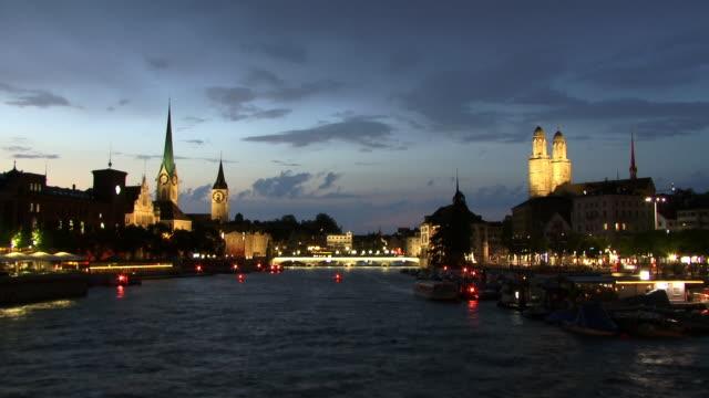 t/l, ws, river and illuminated city, dusk to night, zurich, switzerland - establishing shot stock videos & royalty-free footage