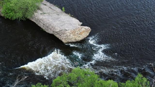river and ruins of a dam - abbandonato video stock e b–roll