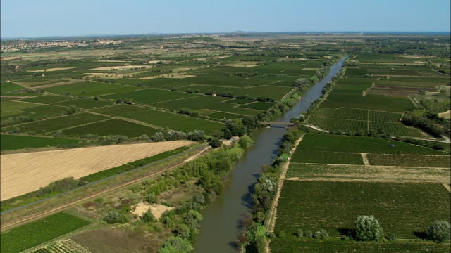 low aerial, river aude crossing fields, aude, france - aude stock videos & royalty-free footage
