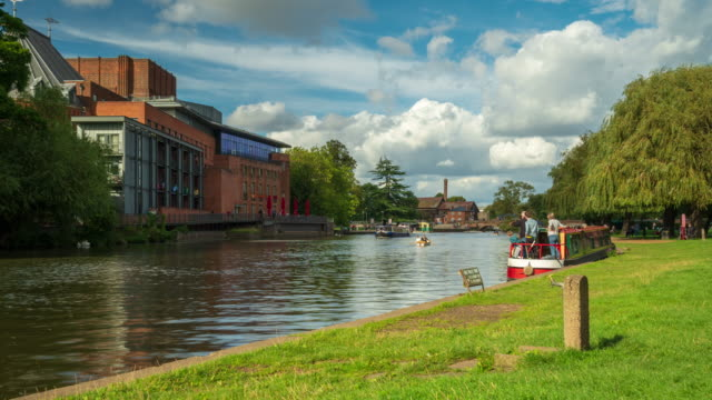 river avon and shakespeare theatre in stratford-upon-avon - 4k time-lapse - barge stock videos & royalty-free footage