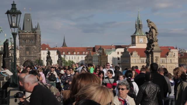 river boats and the vltava from charles bridge, prague, czech republic, europe - stare mesto video stock e b–roll