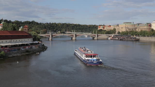 river boats and the vltava from charles bridge, prague, czech republic, europe - river vltava stock videos & royalty-free footage